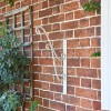 'Turenne' Rustic Cream Hanging Basket Bracket on the Front of  a House