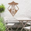 """Get in Loser"" Alien Wall Art in Situ by a Wooden Table Set in the Garden"