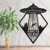 """""""I Want to Believe"""" Alien Wall Art Above a Bush Outdoors"""