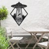 """""""I Want to Believe"""" Alien Wall Art in Situ by a Wooden Table Set in the Garden"""