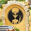 Peace Sign Alien Wall Art in Situ on a Yellow Wall