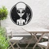 Peace Sign Alien Wall Art in Situ Above a Wooden Garden Furniture Set