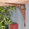 Antique Copper Finish Iron Bridge Shelf Bracket in Situ holding a Wooden Shelf