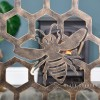 Close-up of the Antique Gold Bee on the Fireguard