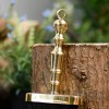 Detailed image of polished brass handle on brush