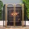 Polished brass four fold firescreen in living room