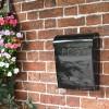 Minimalist black wall mounted letter box
