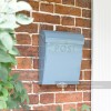 Light  pastel blue post box by front door