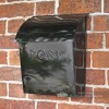 Black contemporary post box mounted on wall