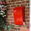 Robust wall mounted mail box with added newspaper holder