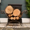 Wrought iron scroll design log holder infront of fireplace