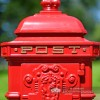 Detailed image of POST picked out in gold on traditional letter box