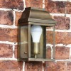 Antique Brass classic wall lantern on brick wall