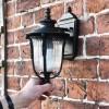 Bronze Christleton Wall Lantern on brick wall scale