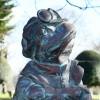 Close up of wind & willows Toad bronze effect garden sculpture