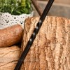 Detailed image of blacksmith twist on handle of brush