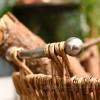 Stylish metal handles on log basket