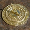beautiful round sundial with sun