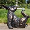 Bird Sitting on Rabbit Garden Sculpture in Situ