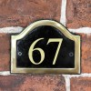 The Number 67 in Vinyl on the Arched Black & Brass Number Plaque
