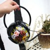 Black Narrowboat Watering Can in Use in the Garden