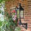 Black Victorian Wall Lantern With Brass Decoration On Wall Bracket