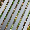 Close-up of the Metal Slates on the Seat of the Bench