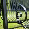 Blacksmith hand forged scroll work arm rest on garden swing bench