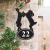 Boxing Hares Iron House Number Sign on a Garden Wall