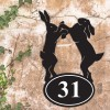 Boxing Hares Iron House Number Sign in Situ a Rustic Wall