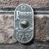 Old fashioned front door bell push on brick wall