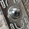Close up image of front door buzzer button
