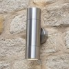 Brushed Aluminium Spotlight Cylinder Wall Light in Situ on a Stone Wall