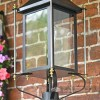 Close Up Of Black Victorian Wall Light With Brass Bar Decoration