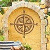 Compass Wall Art in Situ on a Yellow Garden Wall