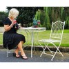 """Freya"" Vintage style Cream Garden Table Set in Situ in the Garden"