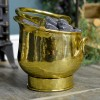 Polished Brass Coal Bucket holding Coal By the Fireplace
