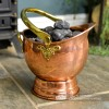 Traditional Copper Coal Bucket Holding Coal