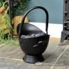 Small Black Coal Bucket Holding Coal