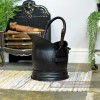 Black Traditional Coal Bucket With Shovel in Situ Next to the Fireplace