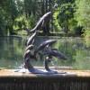 Jumping Fish Sculpture Sculpture in Situ in a Lake