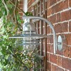View of the Side of the Galvanised Modern Overhanging Wall Light Mounted in a Brick Wall