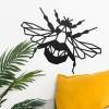Geometric Iron Bumblebee Wall Art in Situ on a Cream Wall