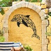 Geometric Dolphin Wall Art in Use on a Yellow Garden Wall