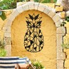 Geometric Steel Pineapple Wall Art in Situ on a Yellow Garden Wall