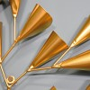 Metal Wall Art with a Gold Cone Tree Design