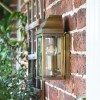 View of the Side of the Antique Brass Wall Lantern Flush against the Wall