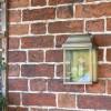 """Heathfield"" Half Wall Lantern Finished in a Antique Brass Finish"