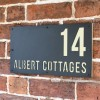"""Cream """"Albert"""" House Sign in Situ on the Wall"""