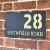 "Cream ""Smithfield"" House Sign in Situ on the Wall"